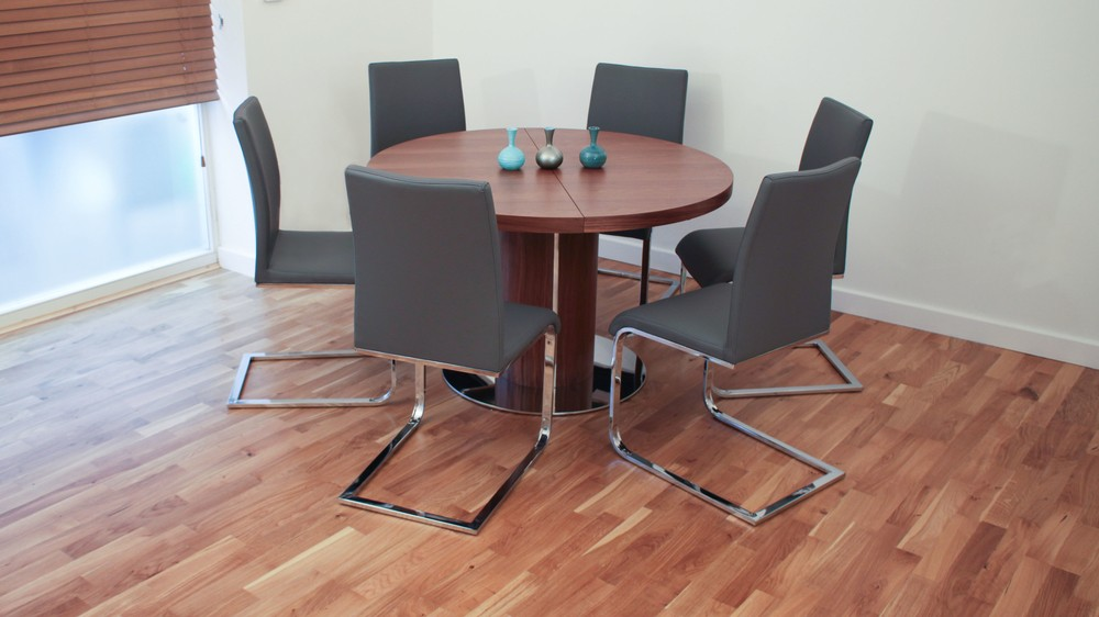 Stylish Cantilever Dining Chairs and Large Round Dining Table