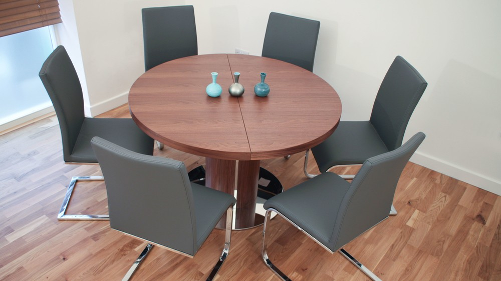 Round Walnut Wood Extending Dining Table and Cantilever Chairs