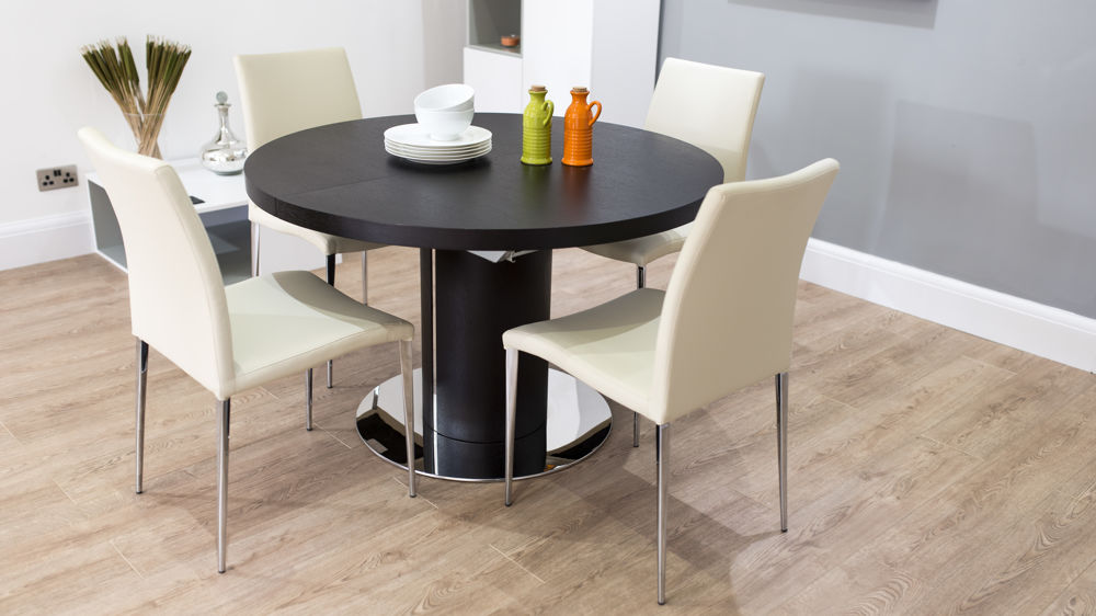 Modern Large Round Dark Wood Extending Dining Table and Faux Leather Dining Chairs