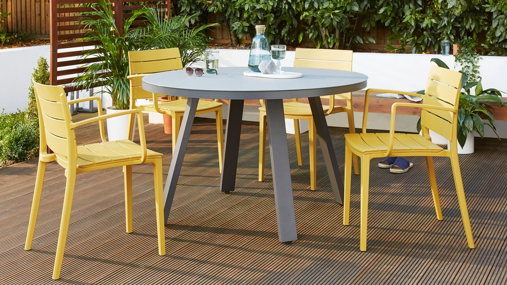 Mustard yellow stackable dining chairs