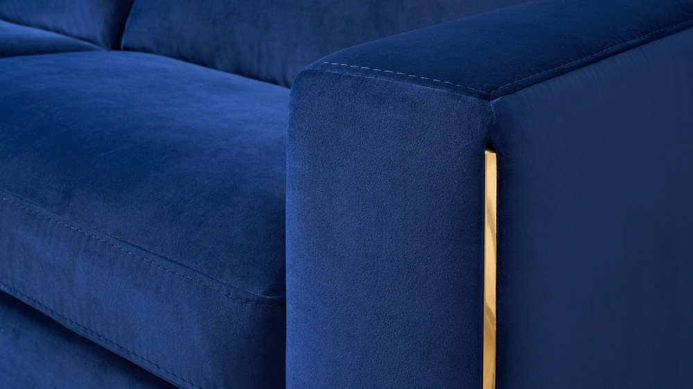 Blue velvet and gold trim sofa