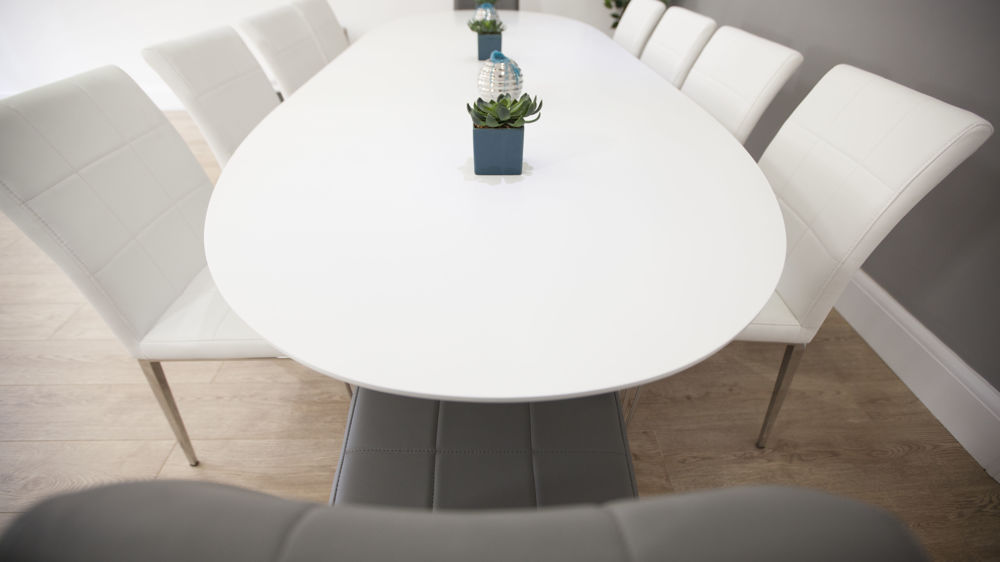 Matt White Oval Dining Table And Modern Dining Chairs