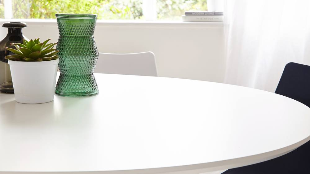extending white oval modern dining table