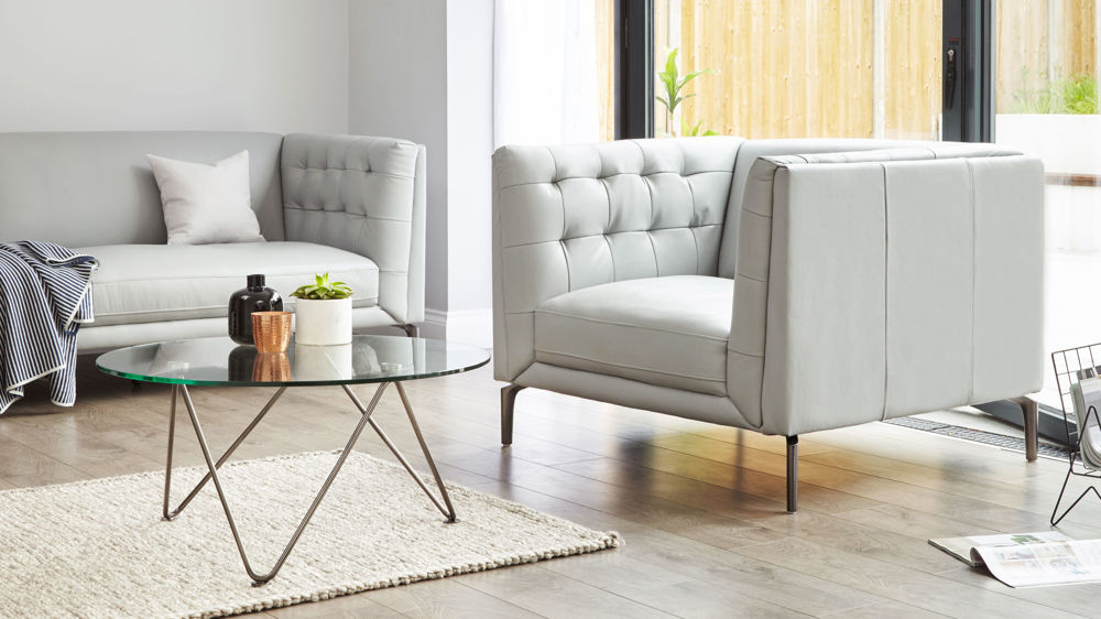 grey modern buttoned leather armchair
