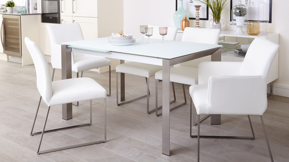 Brushed metal and frosted glass extending dining table