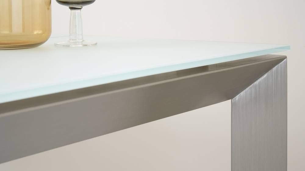 Brushed metal extending dining table with frosted glass top