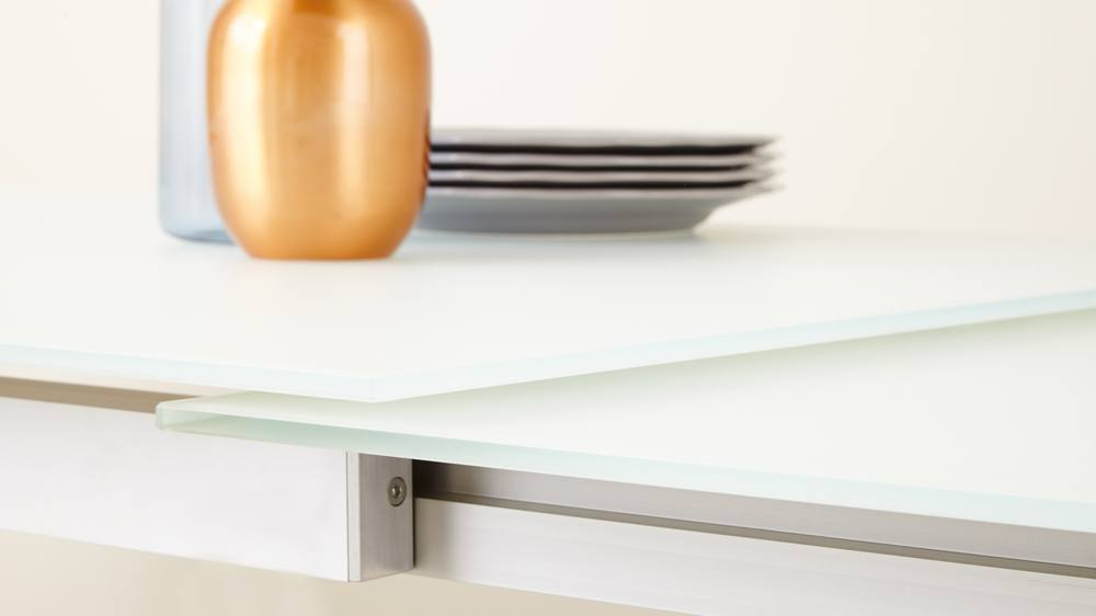 White glass and brushed metal extending table