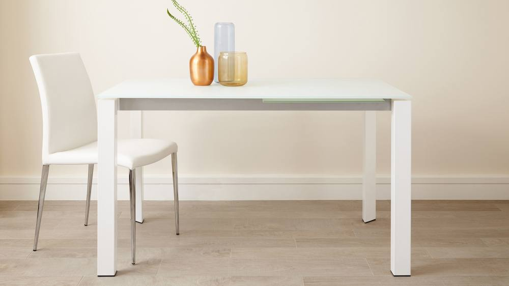 Frosted white glass extending dining table with white legs
