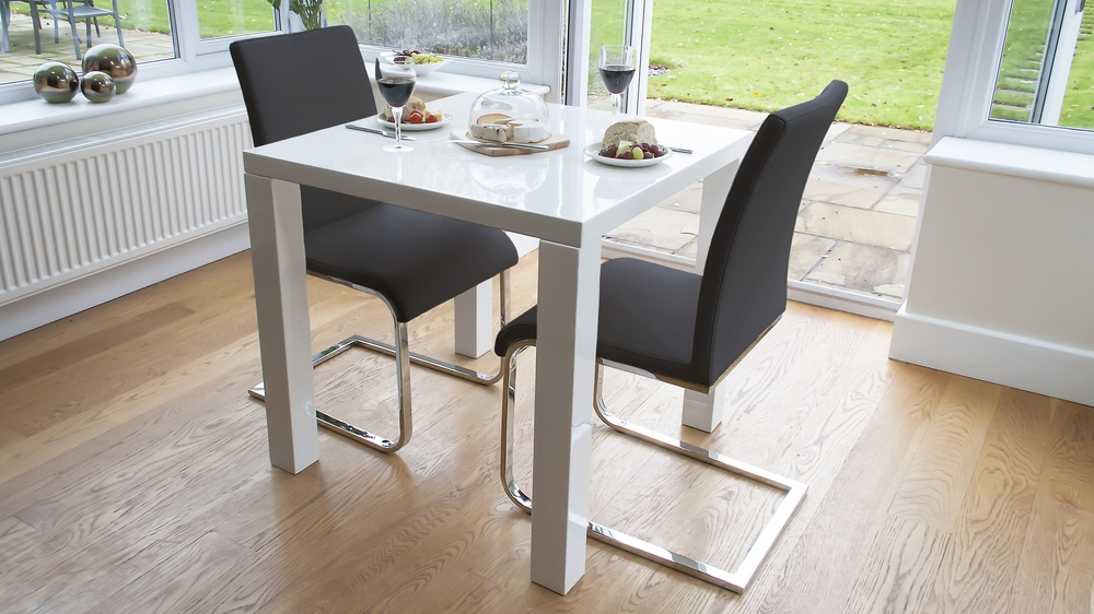 White Gloss Small Table and Black Dining Chairs