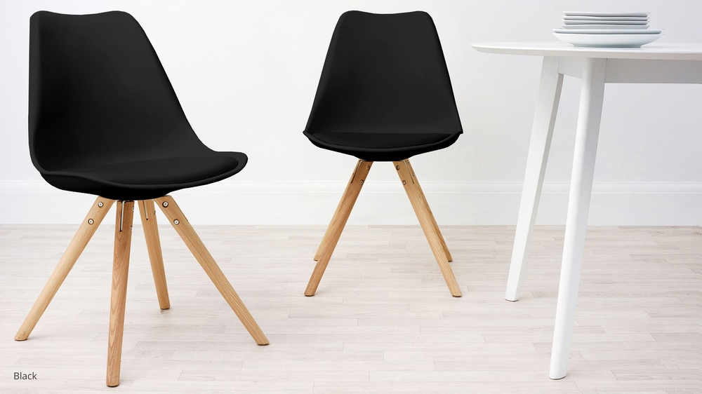 black dining chairs with wooden legs
