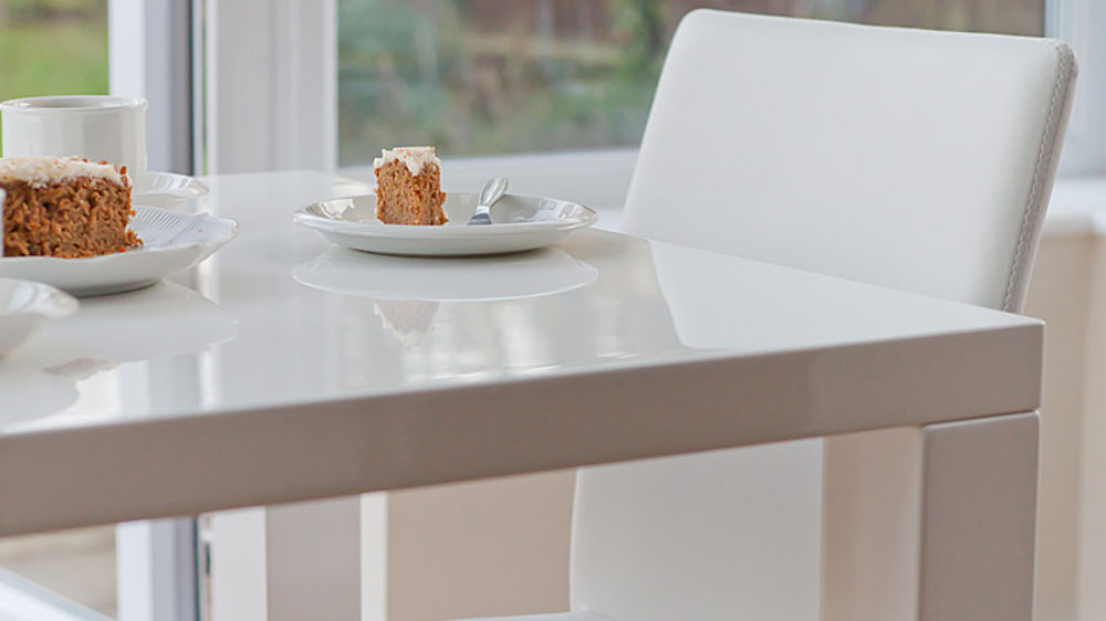 White Gloss  Seater Table and Eames Style Dining Chairs UK