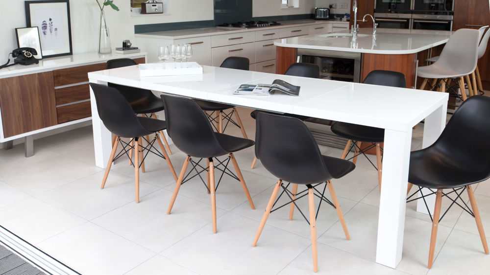 Comfortable Black Eames Style Dining Chairs and White Gloss Table