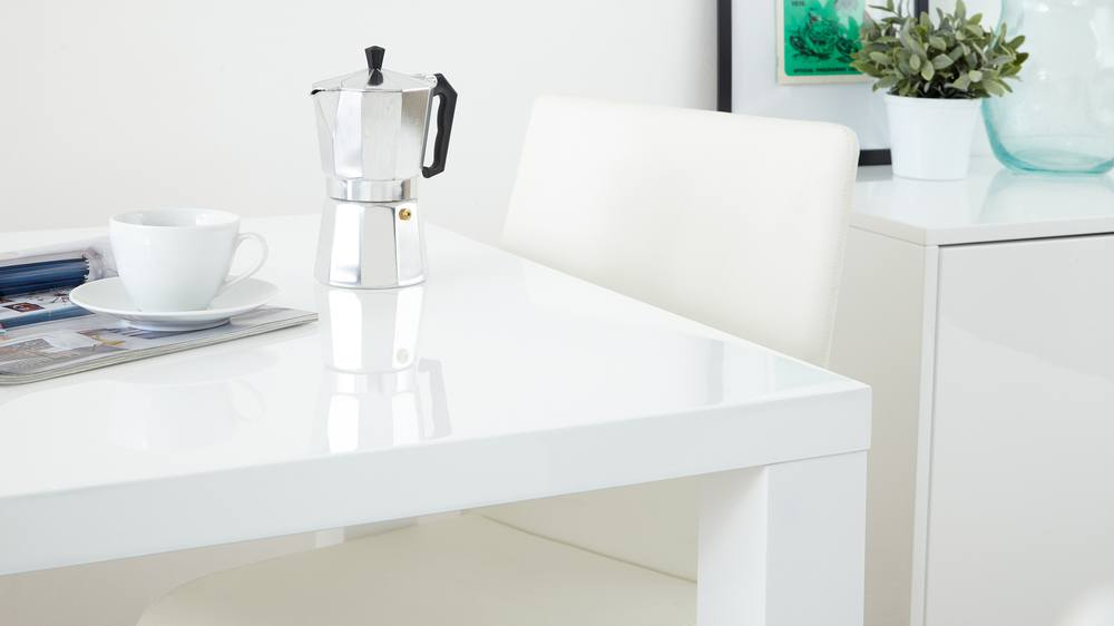 sleek white dining table