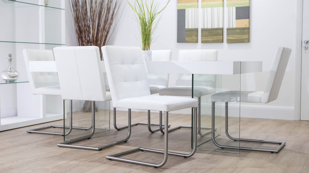 White Cantilever Dining Chairs and Glass Legged Dining Table