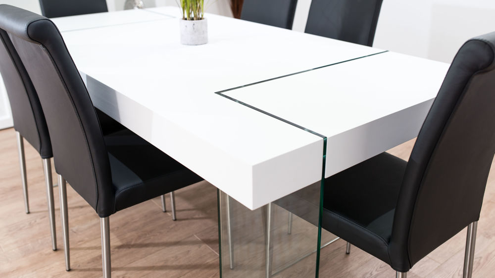 White Dining Table with Glass Legs and Black Dining Chairs
