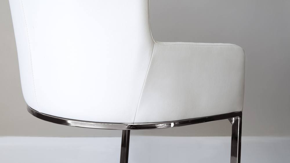 White faux leather and chrome armchair