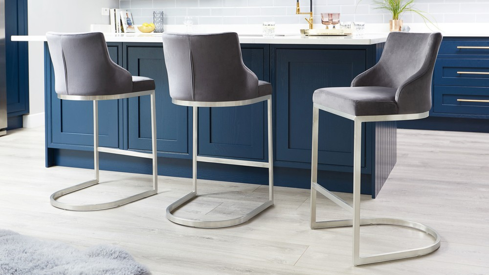 Light grey velvet bar stools with backrest