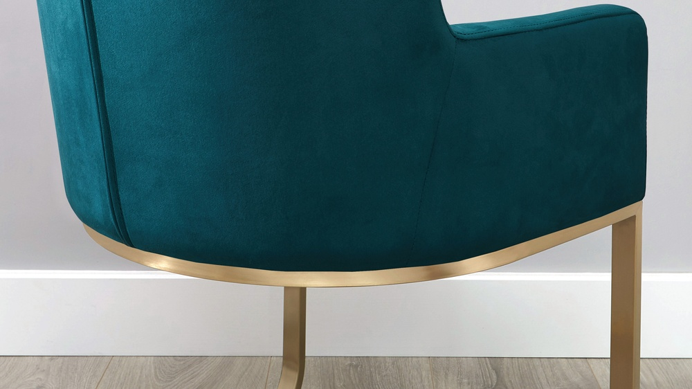 Velvet and brushed brass dining chairs