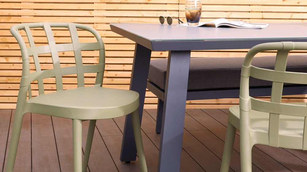Grey glass outdoor table and skye stacking chairs