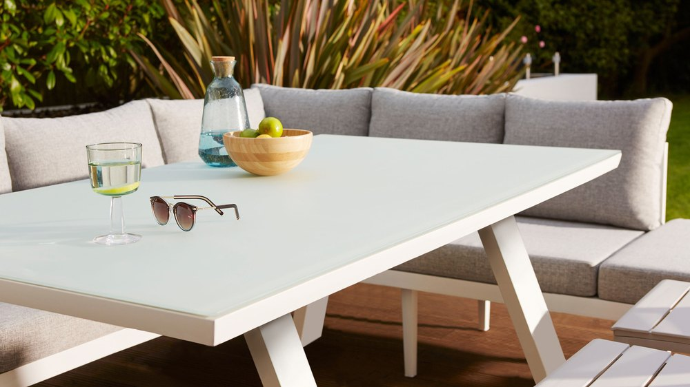 White trestle outdoor glass table