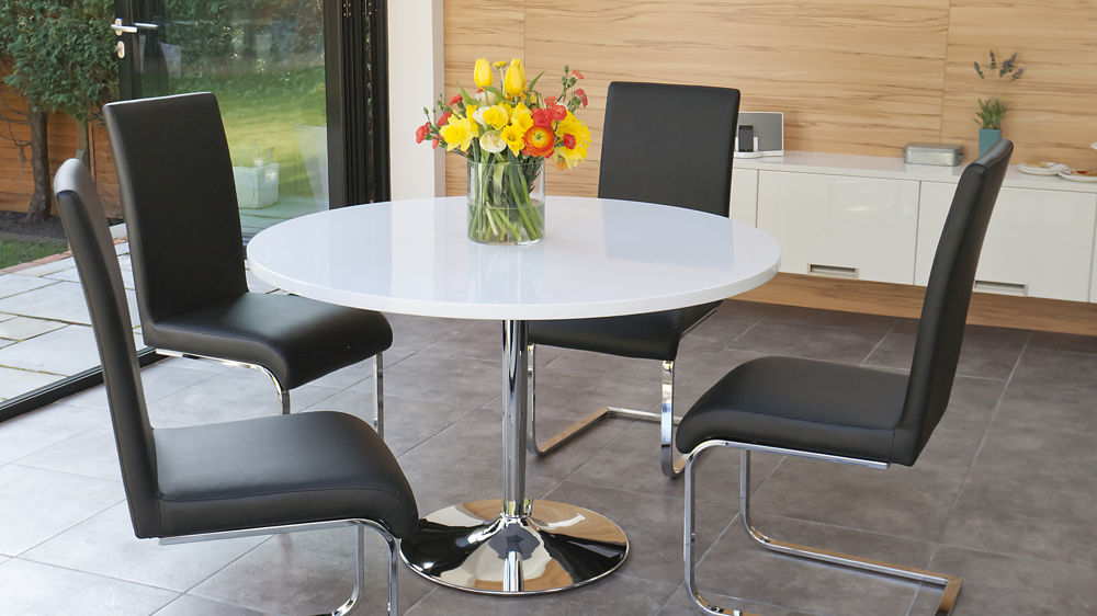 Black Swing Chairs and Round White Gloss Dining Table
