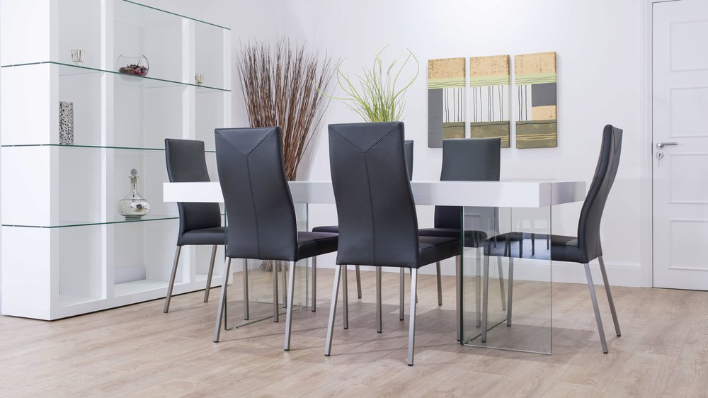 White Dining Table And Black Real Leather Chairs