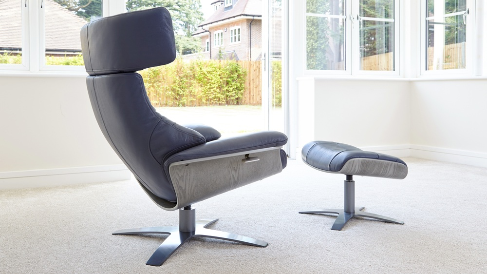 Leather eames style reclining armchair with footstool