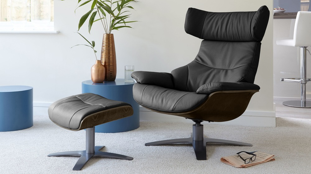 Black leather karma chair with dark wood