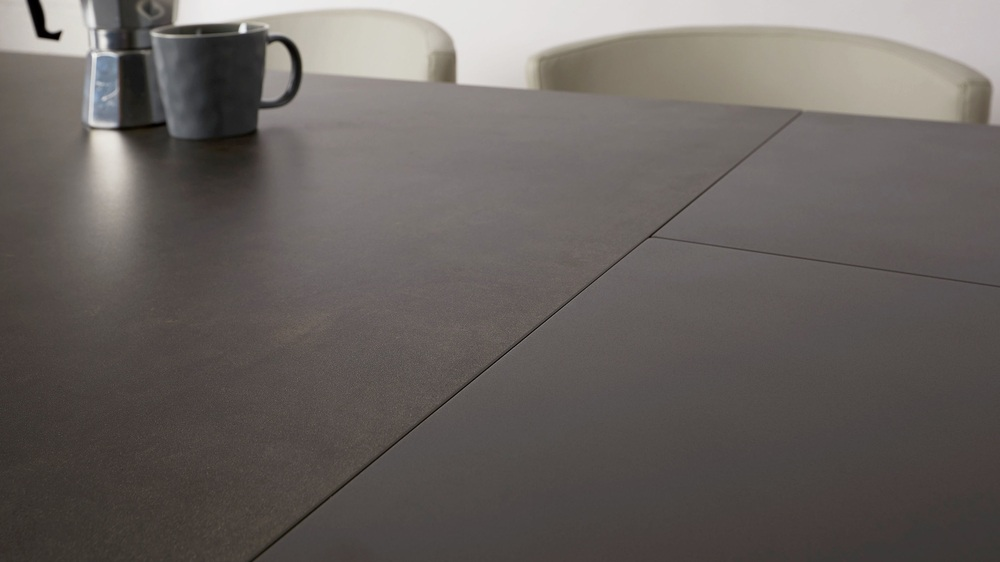 Dark grey ceramic 4-8 seater dining table