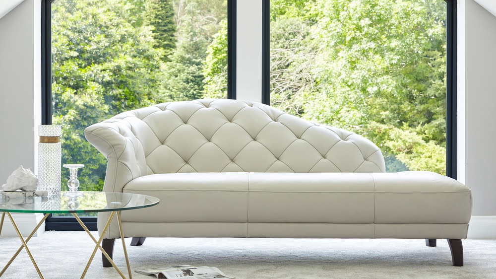 white modern leather chaise lounge UK