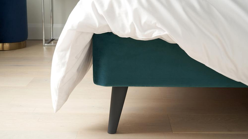 Teal velvet and black wooden leg bed