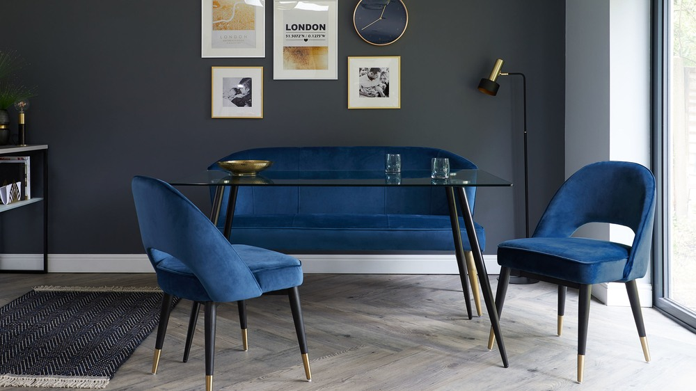 dark blue velvet bench with brass legs