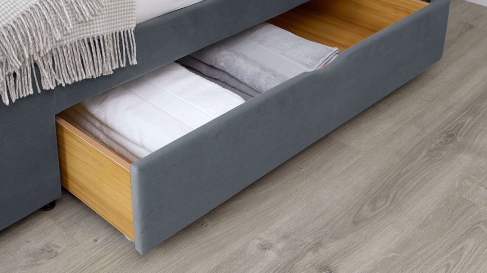 dark grey sleigh bed with drawers