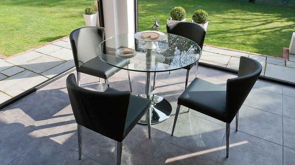 Large Round Dining Table and Black Dining Chairs