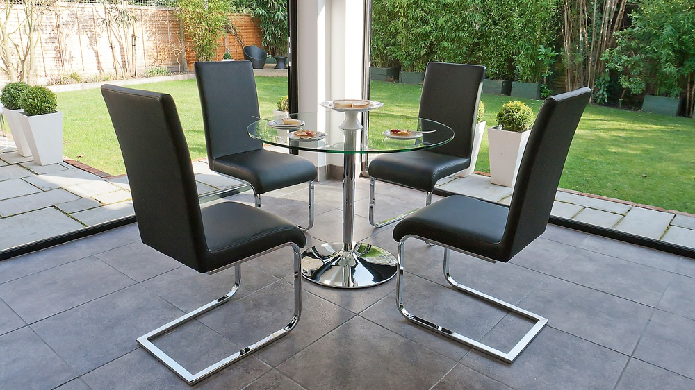 Large Round Glass Dining Table and Black Dining Chairs