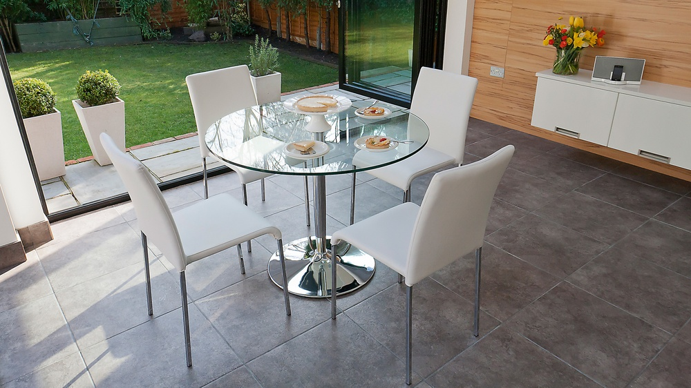 Stylish Dining Chairs and Large Round Glass Dining Table