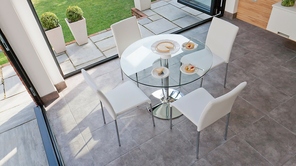 Modern Round 4 Seater Glass Dining Table and Stackable Dining Chairs