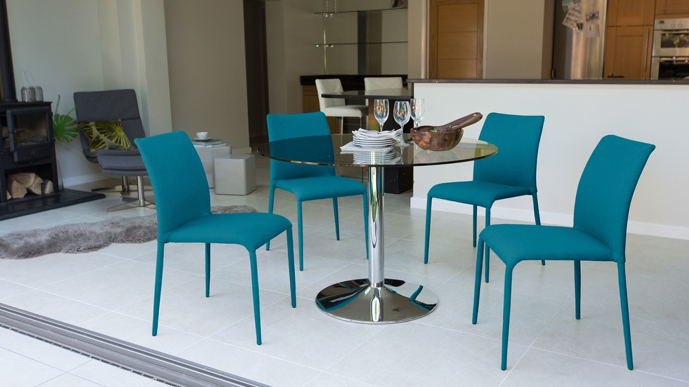 Teal Coloured Dining Chairs and Glass Table