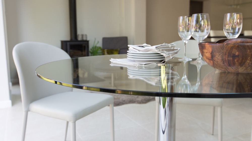 glass and chrome round four seater pedestal table