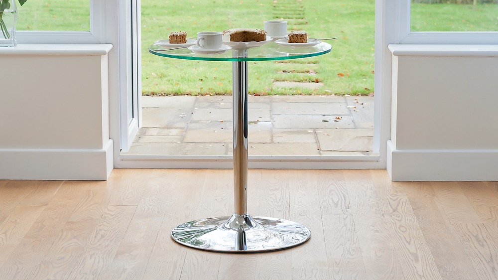 contemporary round glass and chrome pedestal table