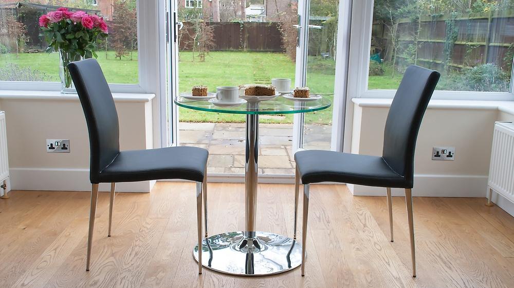 Round Glass 2 Seater Table and Black Dining Chairs