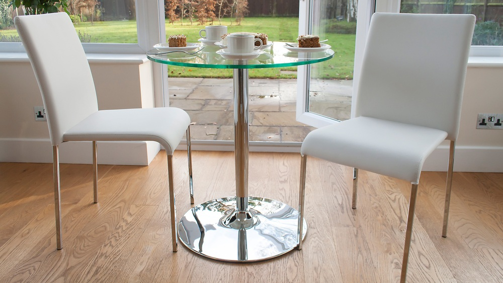 Round Glass 2 Seater Table and White Stackable Chairs