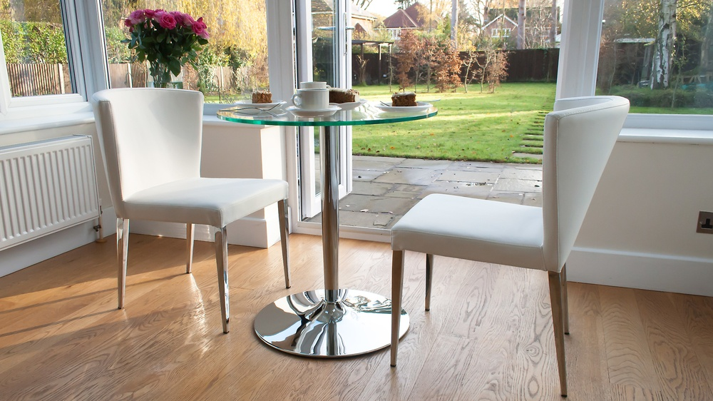 clear glass and chrome pedestal dining table