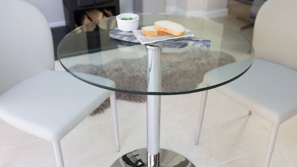clear glass pedestal dining table