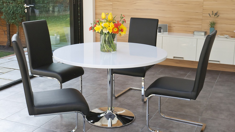 Modern White Gloss Dining Table and Black Swing Chairs