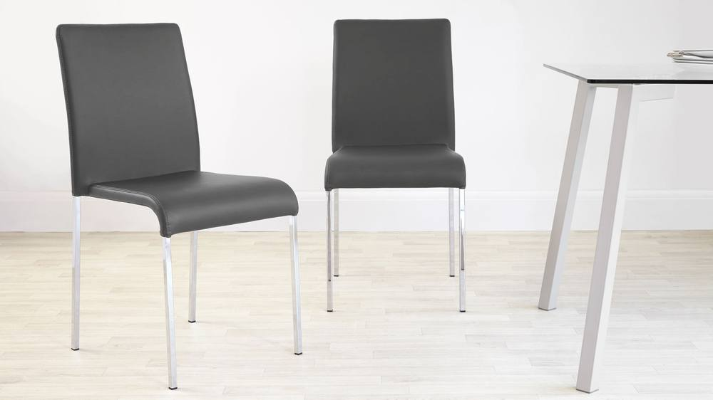 Dark grey faux leather and chrome dining chairs