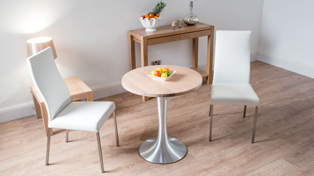 white dining table set with upholstered dining chairs and ch