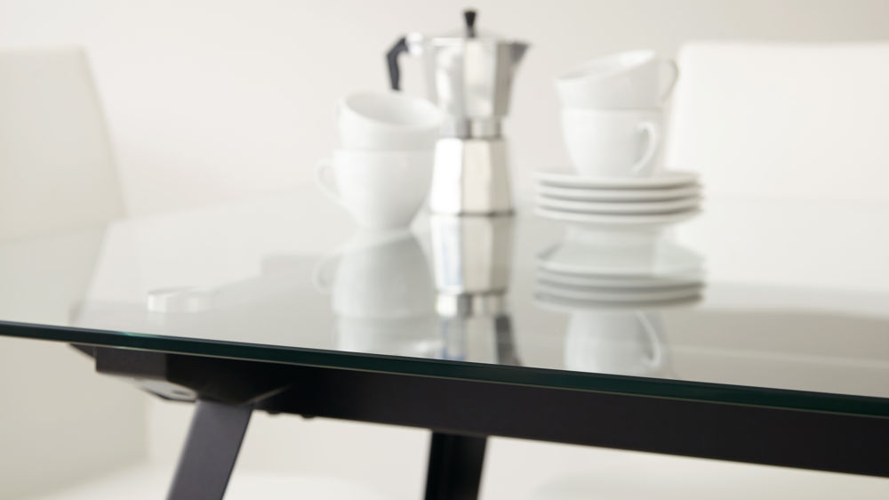 large modern glass dining table seats six to eight