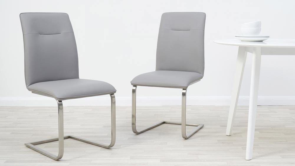 Light grey faux leather dining chairs