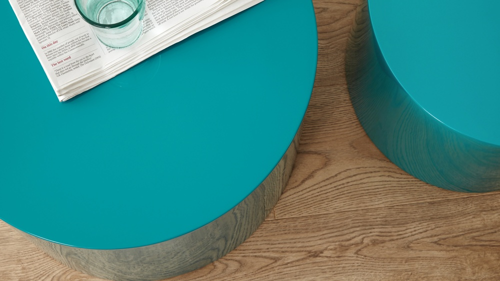 two gloss side tables in teal